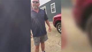 Woman confronts man flying Nazi flag from home