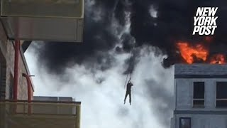 Man narrowly escapes a towering inferno on a crane hook | New York Post
