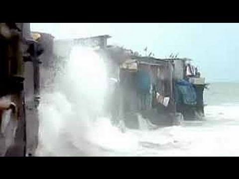 Houses in Mumbai where sea waves splash as far as into the l