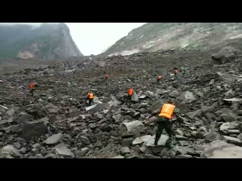 China: Over 100 people feared buried in landslide