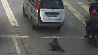 Child run over after falling from moving car