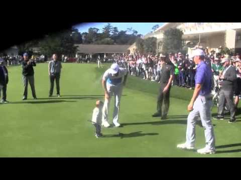 DJ with his 13 month son having fun with Jordan on putting green