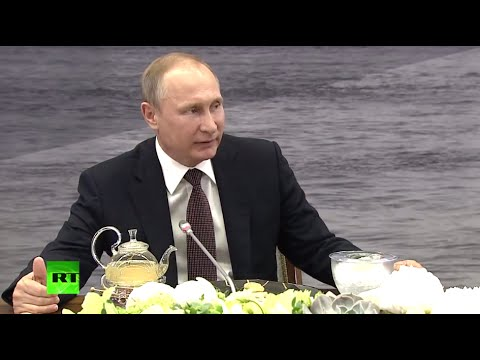 Putin talks to world news agencies at St. Petersburg Economi
