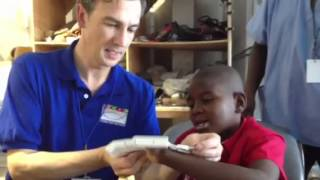 California Software Engineer Uses Talents to Help Child(Stevenson, a 12-year-old Haitian boy missing most of his fingers, is fitted for a robotic hand by John Marshall and Food For The Poor., 2014-04-07T16:01:10.000Z)