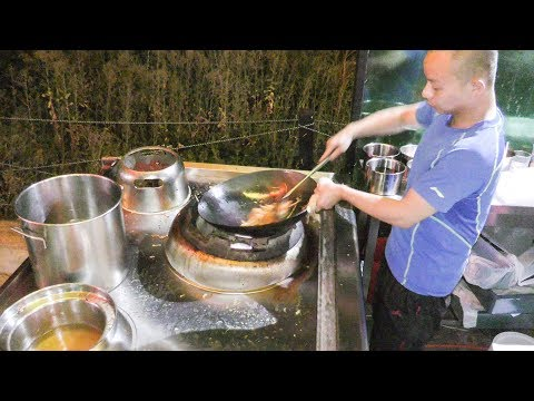 Very Fast Cooking Hand Made Noodles in a Chinese Wok at Street Food Festival in Warsaw Poland