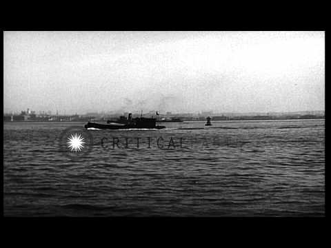 A view of tug boats pushing oil barge across Hudson River in United States. HD Stock Footage