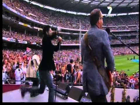 INXS perform live at the 2010 AFL Grand Final