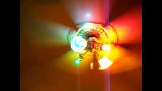 Sierra Victorian Copy ceiling fan with white blades and colored light-bulbs