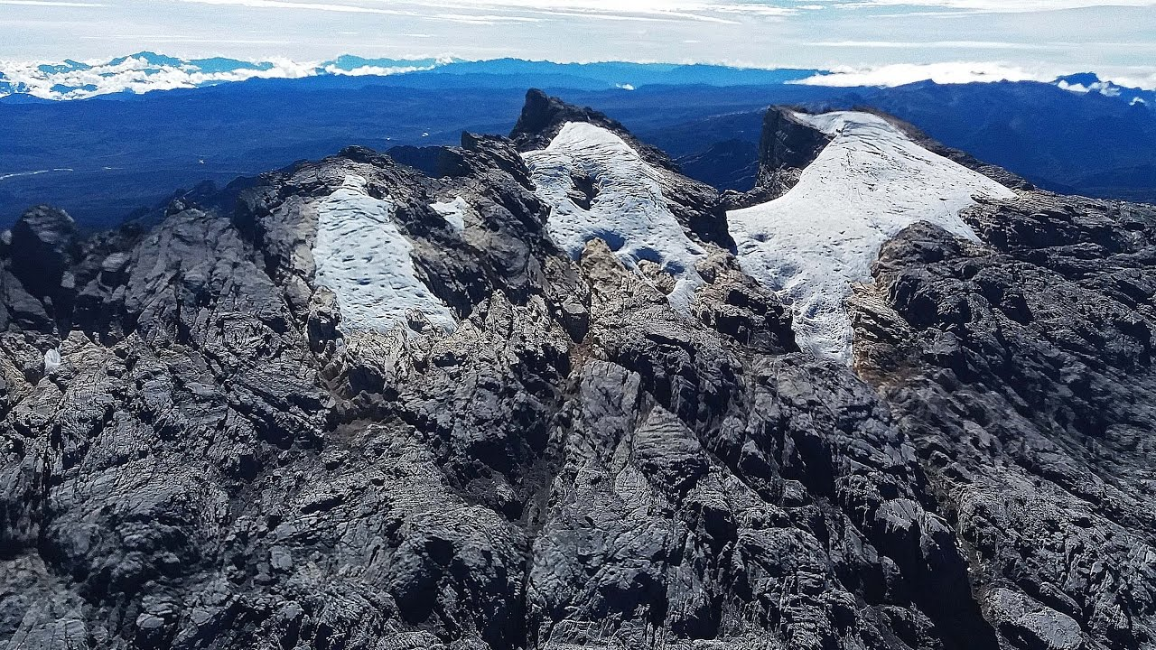 Flying In Papua Cessna C208b Pk Ltf Over Puncak Jaya Glaciers Grasberg Mine Youtube