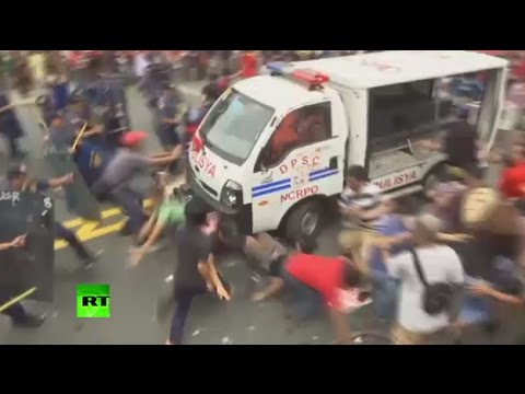 Philippines police van rams protesters during rally outside