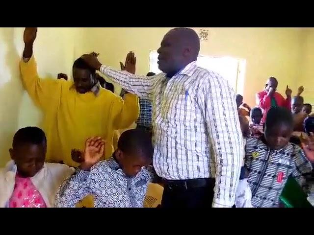 Haron Praying for 4 Children WFF Moi's Bridge Kenya 9-2-2018