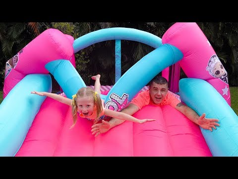 Stacy and dad fun playing with Inflatable water slide