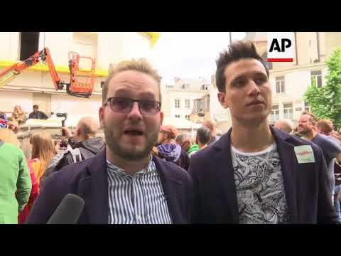 Some revellers channel UK royal wedding at Belgium gay pride event