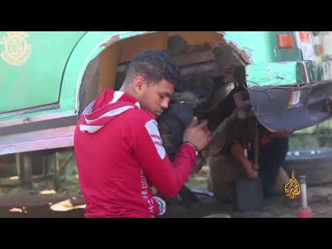 هذا الصباح-شاب مصري مبتور الساقين يمتهن إصلاح السيارات