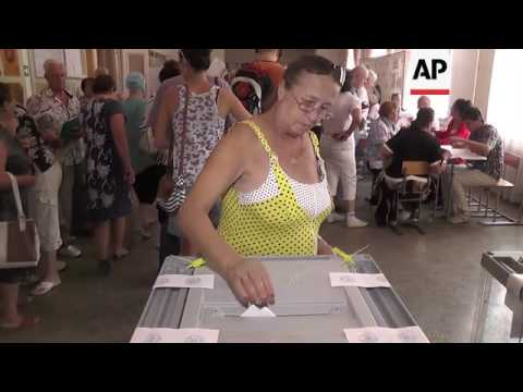 Residents of annexed Crimea vote in Russian elex
