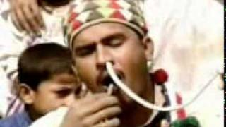 a pakistani man putting snake in his nose.3gp