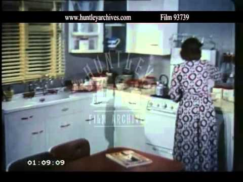 Housewife in 1950's Kitchen.  Archive film 93739