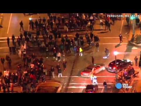Raw: Peaceful protestors won't let violence stop them