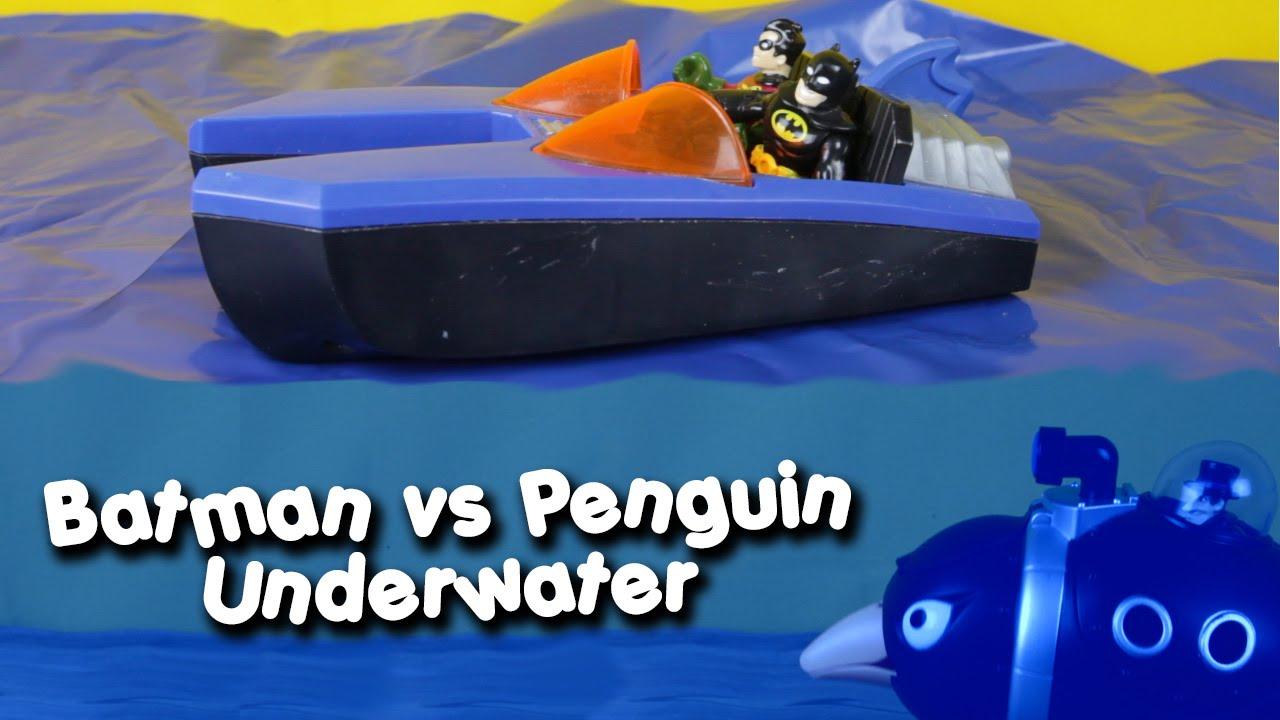 Batman and Robin in batboat stop Penguin in his underwater ...
