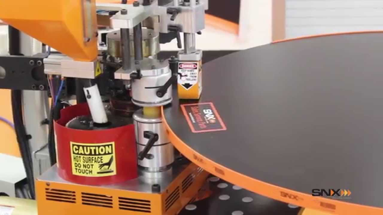 SNX nVision Contour Edge Bander Edging a Round Laminate Tabletop