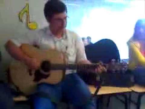 Scott Bird playing guitar at Nucla High School