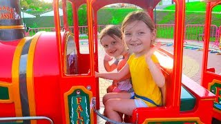We are in the Train Wheels On The Bus Song Nursery Rhymes & Kids Songs