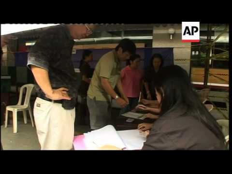 Yingluck Shinawatra casts ballot as polls open