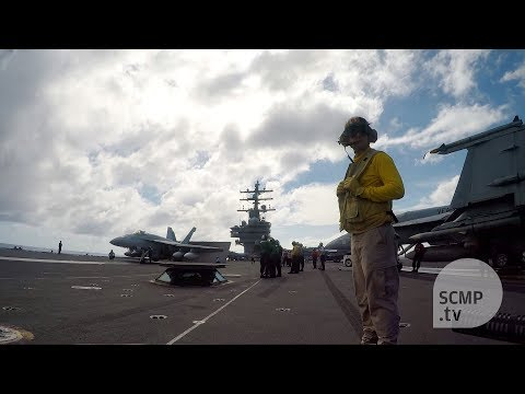 Supercarrier USS Ronald Reagan patrols the South China Sea