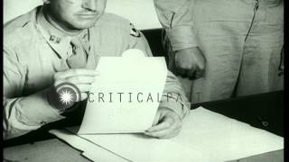 German prisoners write letters to the US Captain and purchase cigarettes wit...HD Stock Footage