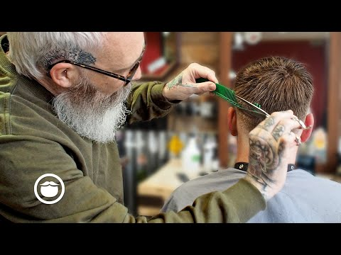 master-barber-gives-a-low-fade-with-textured-top-haircut