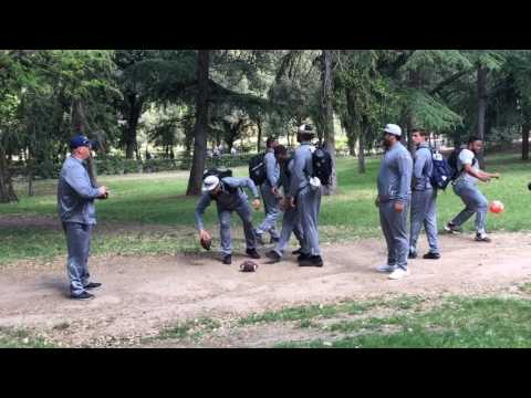 Jim Harbaugh, Michigan toss the football around Borghese Gardens