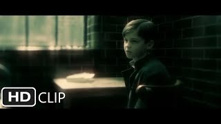 Who does albus dumbledore meet to ask about tom riddle's childhood at the orphanage?
