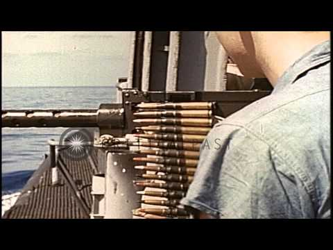 A machine gun aboard a ship being fired at underwater mines in the Pacific Ocean ...HD Stock Footage