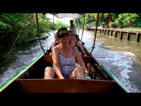 Longtail boat ride along canal....Thailand.