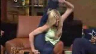 Brooke Burns puts her leg behind her head