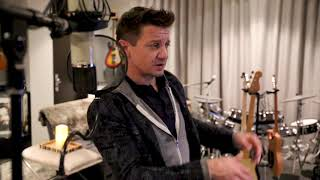 Jeremy Renner in his home studio