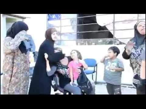 Israeli soldiers hitting Muslim Palestinian women!