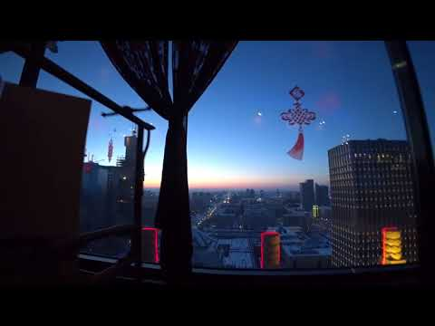 Вращающийся ресторан на 23 этаже отеля Пекин Палас