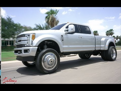 2017 F350 Dually on 24 inch American Forces and a 6 inch lift to clear 37s!