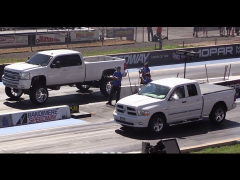 Monster Twin Turbo Duramax Diesel vs Stock Dodge Ram 1500 Drag Race