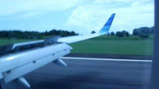 Garuda Indonesia landing at Sepinggan Airport, East Borneo