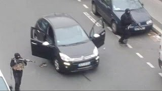 Hooded gunman storm Paris office of satirical magazine Charlie Hebdo