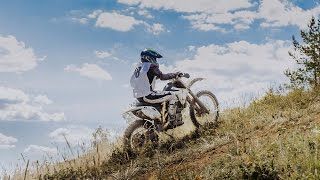 racer enduro motorcycle rides to mountain