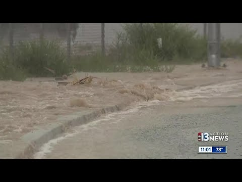 Rain, flooding, water rushing through streets in northwest Las Vegas