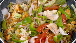 Top shot of chopped and sliced vegetables mixed with spices being fried in hot oil in a non stick fryingpan