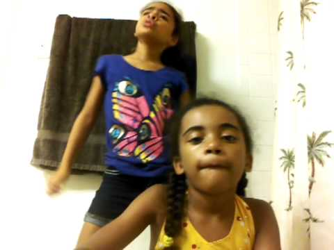 Little girls sing it up with their tablet cam