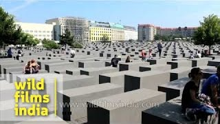 Holocaust Memorial, Berlin, Germany, with kids running over stones