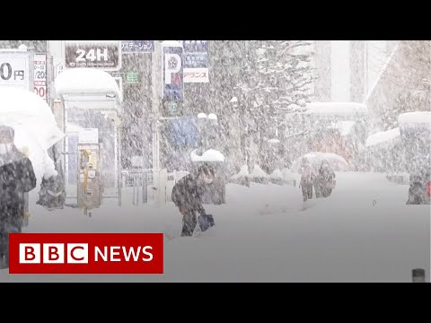 Snow storms bring deadly chaos to Japan - BBC News