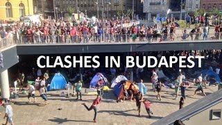 Hooligans vs refugees: Clashes at Budapest train station
