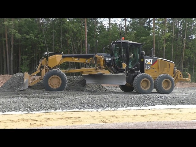 Cat 160M with Topcon 3D GPS spreading gravel part 2